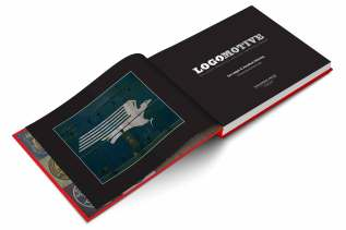 In this colour photograph, the book Logomotive lays open displaying an image of the Missouri Pacific eagle logo.