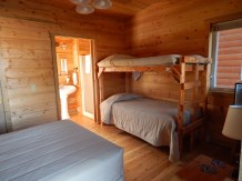 Cabin with full size bed & bunks