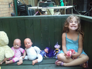 Ella with her dolls - - Ella's birth story