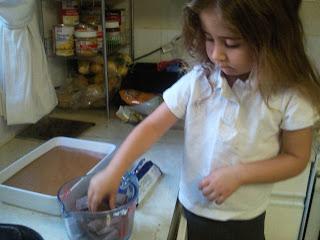Ella breaking the chocolate
