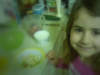 KayCee making strawberry yogurt smoothies