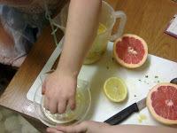 KayCee and Ella making citrus wake-up