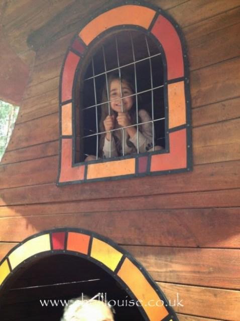 Ella in a playhouse