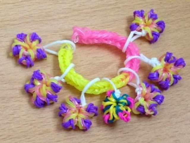 Loom band bracelet with loom band flowers hanging off it