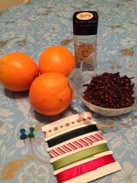 Christmas pomanders - oranges, cloves and Christmas ribbon