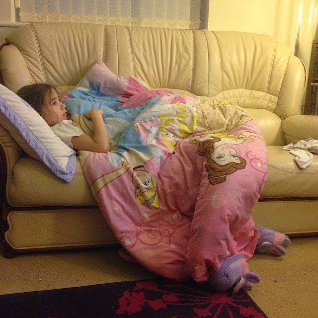 Ella on the sofa watching Barbie