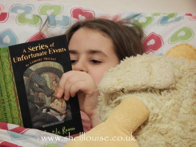 KayCee reading Lemony Snicket