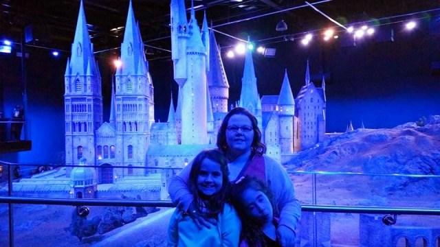 Harry Potter Studio Tour - Kellyann, Kaycee and Ella in front of the Hogwarts model