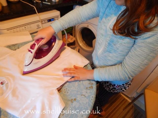 designing t-shirts - Kaycee ironing on her transfer