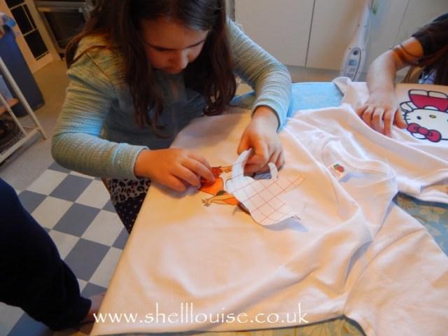 designing t-shirts - Kaycee peeling off her backing paper