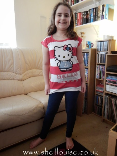 Kaycee wearing Hello kitty t-shirt from Lamaloli