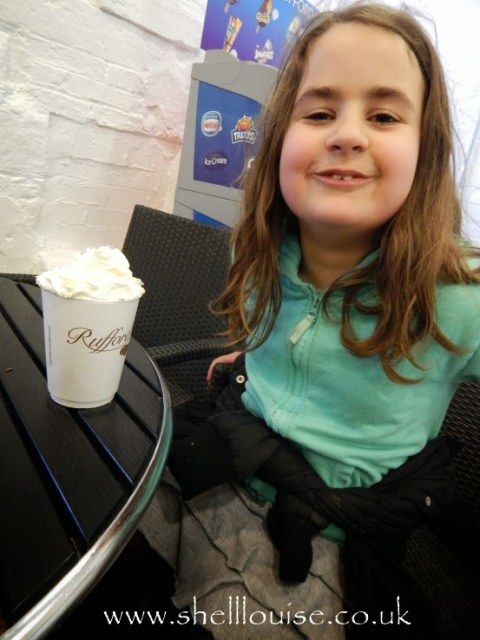 Kaycee with her hot chocolate and squirty cream at Rufford Abbey