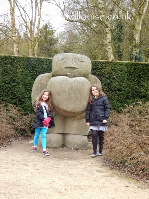 Kaycee and Ella in front of a Sculpture of a man at Rufford Abbey