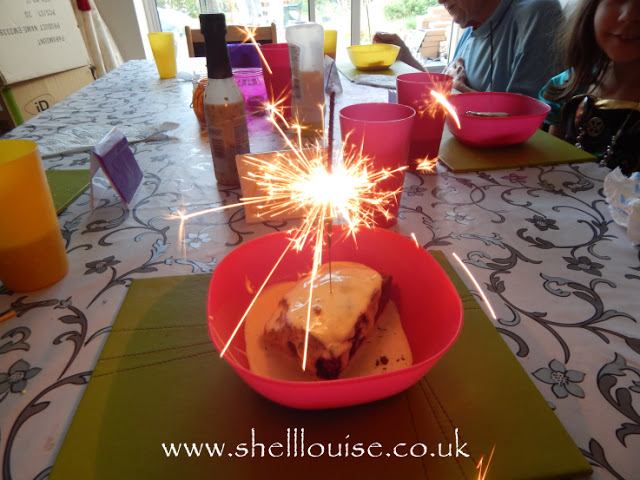 Chocolate brownie with a sparkler stuck in