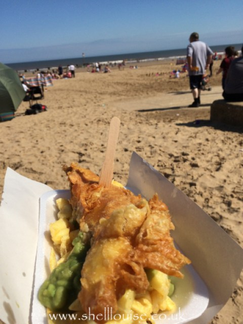 Fish chips and mushy peas at the beach