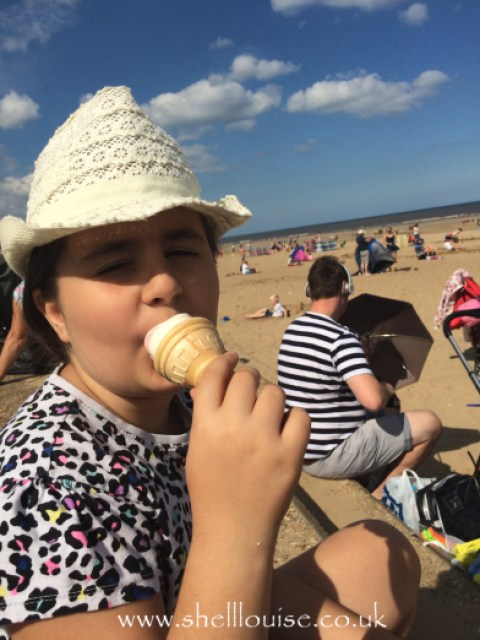 Kaycee on the beach, eating ice cream