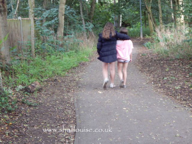 Sisters - Kaycee and Ella walking together in the woods