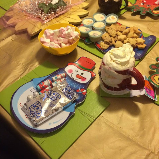 Pop tarts, snowman marshmallows, shortbread and hot chocolate
