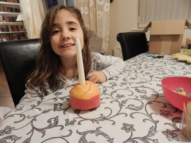 Ella making a Christingle