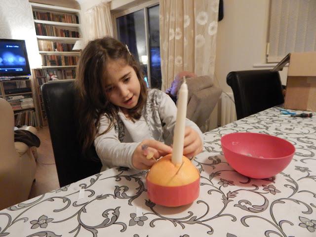 Ella making a Christingle