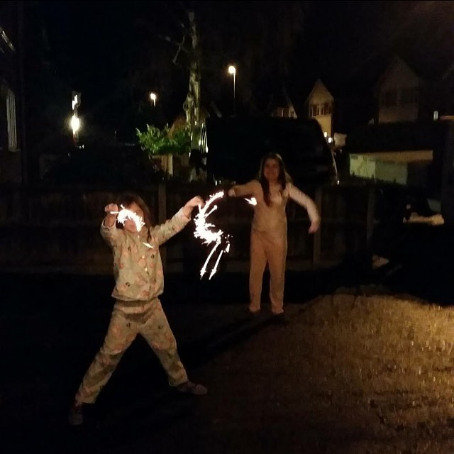 Kaycee and Ella with sparklers on new years eve