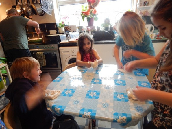 Kaycee, Ella, Lily-May and Nathan making pizza