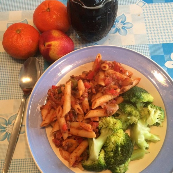Spaghetti bolognese with broccoli. Oranges, nectarine and fizzy drink