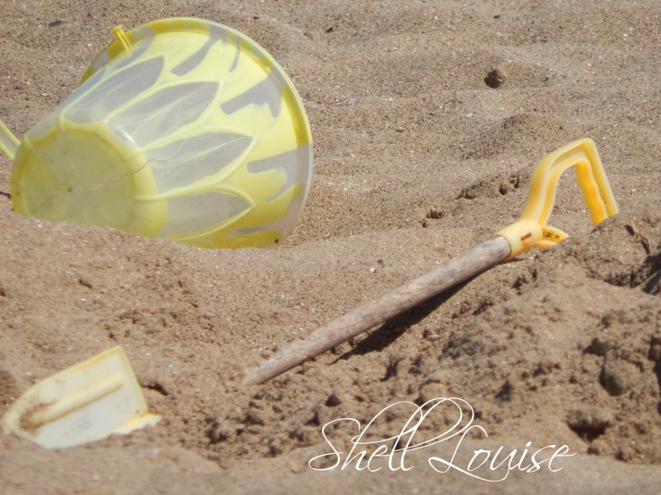 bucket and spade on the sand - holiday