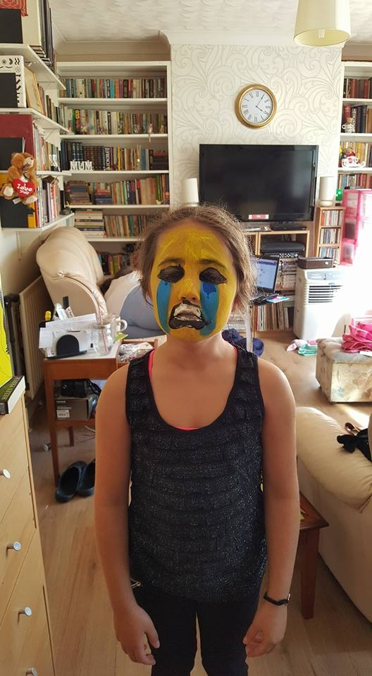 painted emoji faces Ella