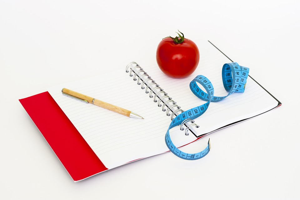 food diary. pen, tomato and tape measure