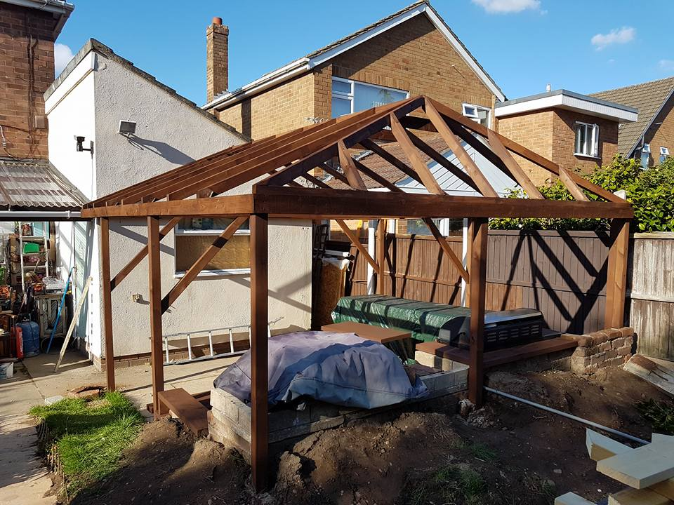 framework for cover over patio. Just needs a roof