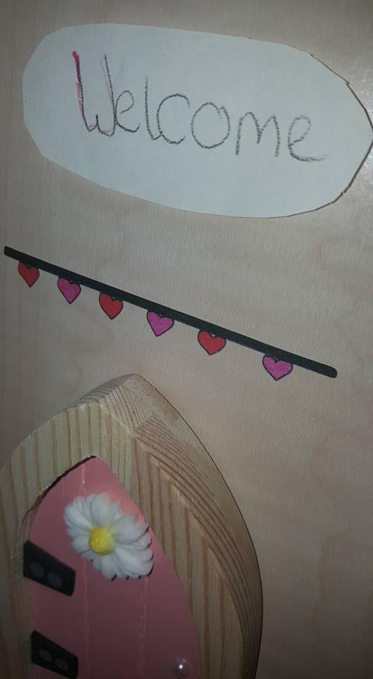 Welcome sign above the fairy door