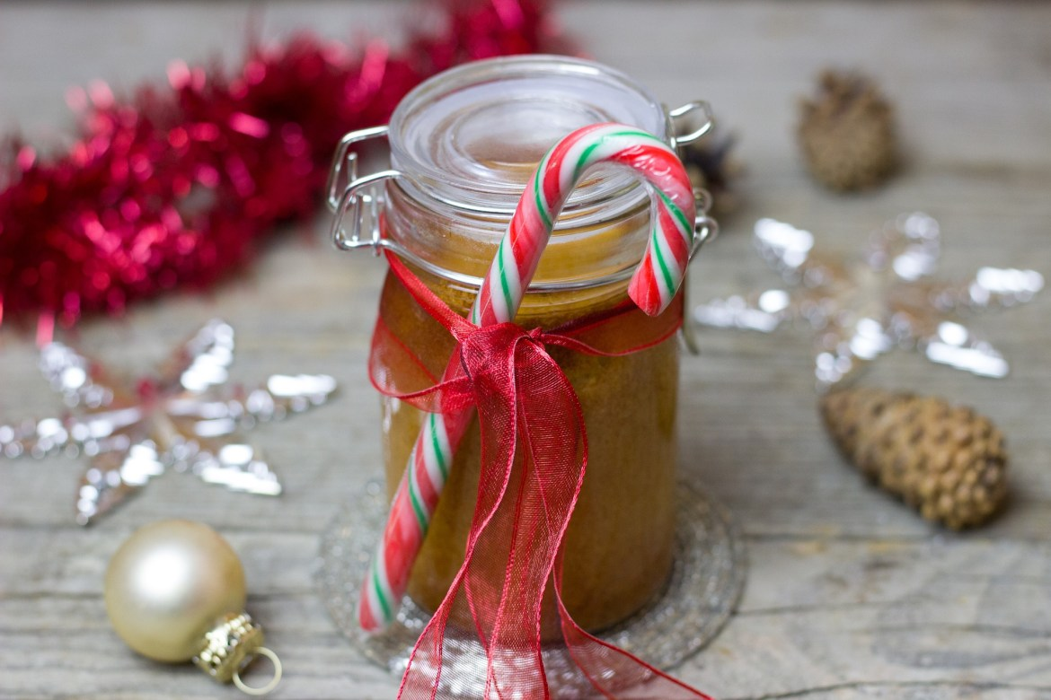edible gifts - caramel sauce in a jar with a candy cane for decoration