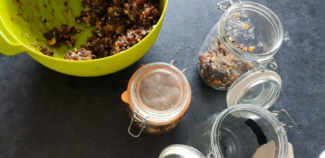 bowl of mincemeat and jars for canning