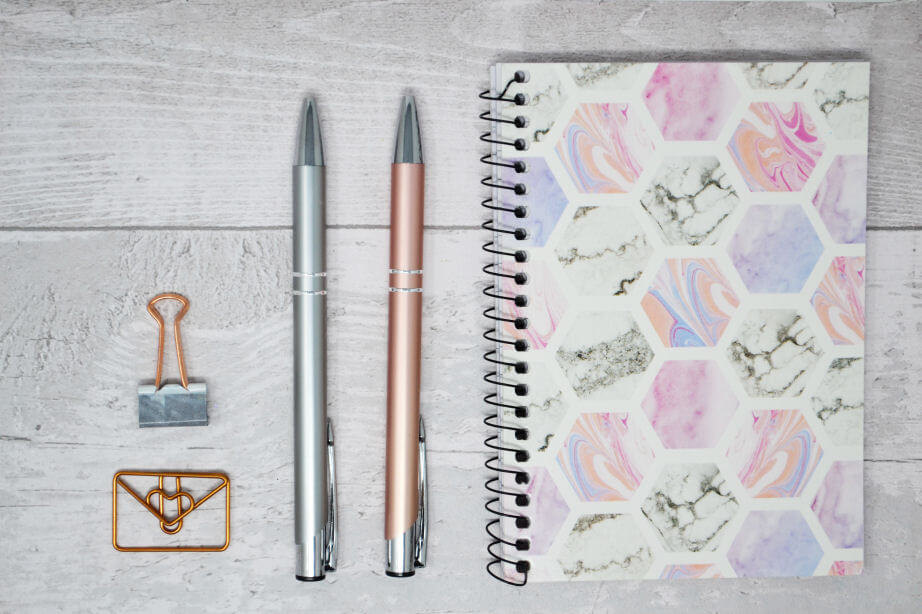 blog flatlay - floral notebook, silver pen, rose gold pen and paperclips