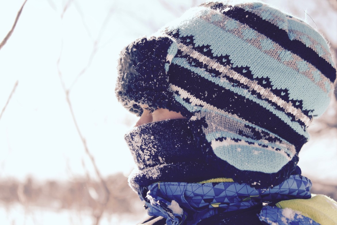 Girl bundled up in Winter clothing - choosing a Winter coat for your child