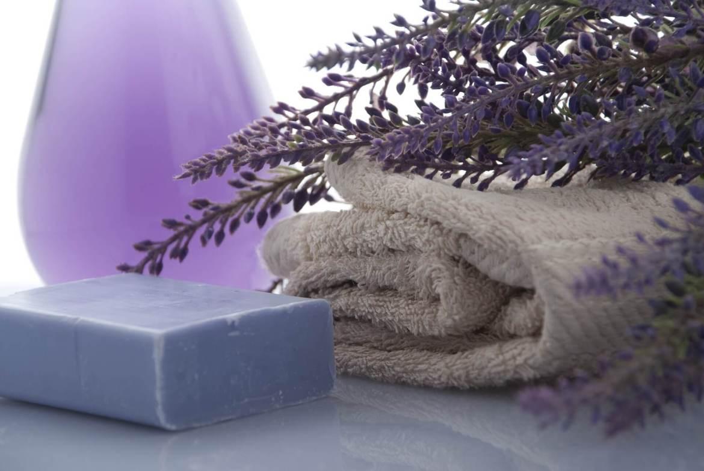 lavender, bathroom towel, lavender soap and a lilac coloured vase