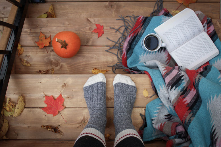 feet with socks on, a small pumpkin and autumn leaves - autumn activities