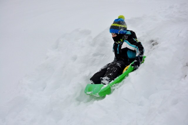 a boy sledging - Winter like it used to be