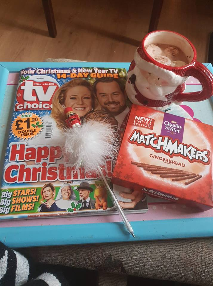 Christmas tv guide, box of matchmakers, hot chocolate with marshmallows and a Nutcracker pen to circle what we're going to watch