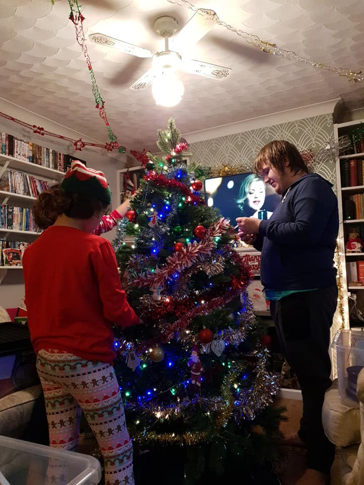 Aiden, KayCee and Ella decorating the tree