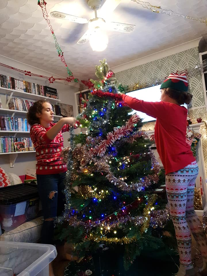 KayCee and Ella decorating the tree