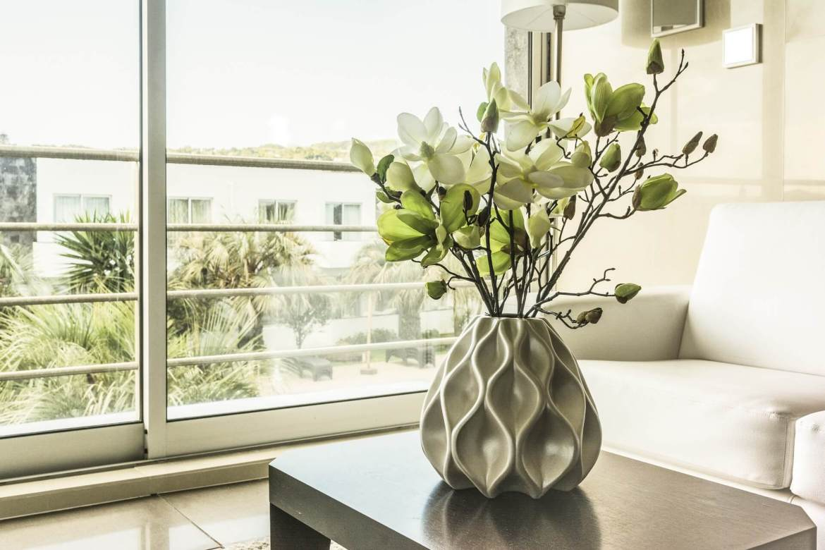 vase of flowers in front of the window