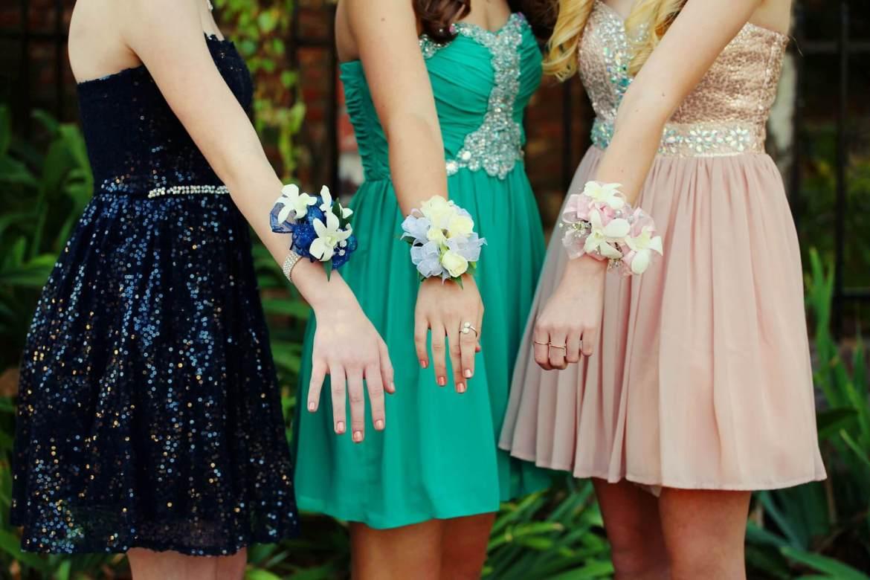 girls wearing prom dresses