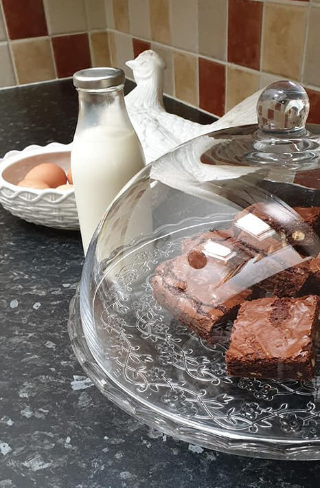 Homemade brownies, milk and eggs at Felin Fach cottage, Pumsaint, Wales