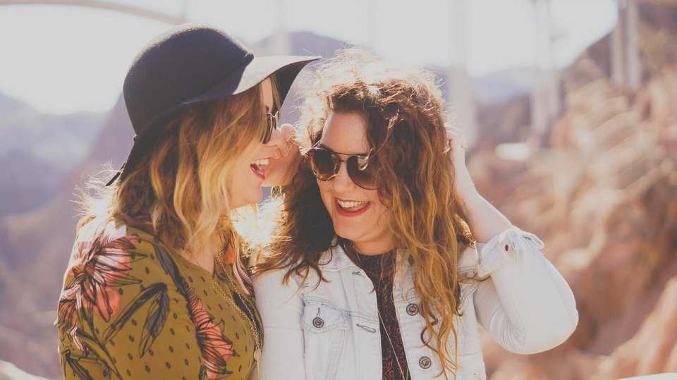 two women laughing together - Juvederm dermal fillers