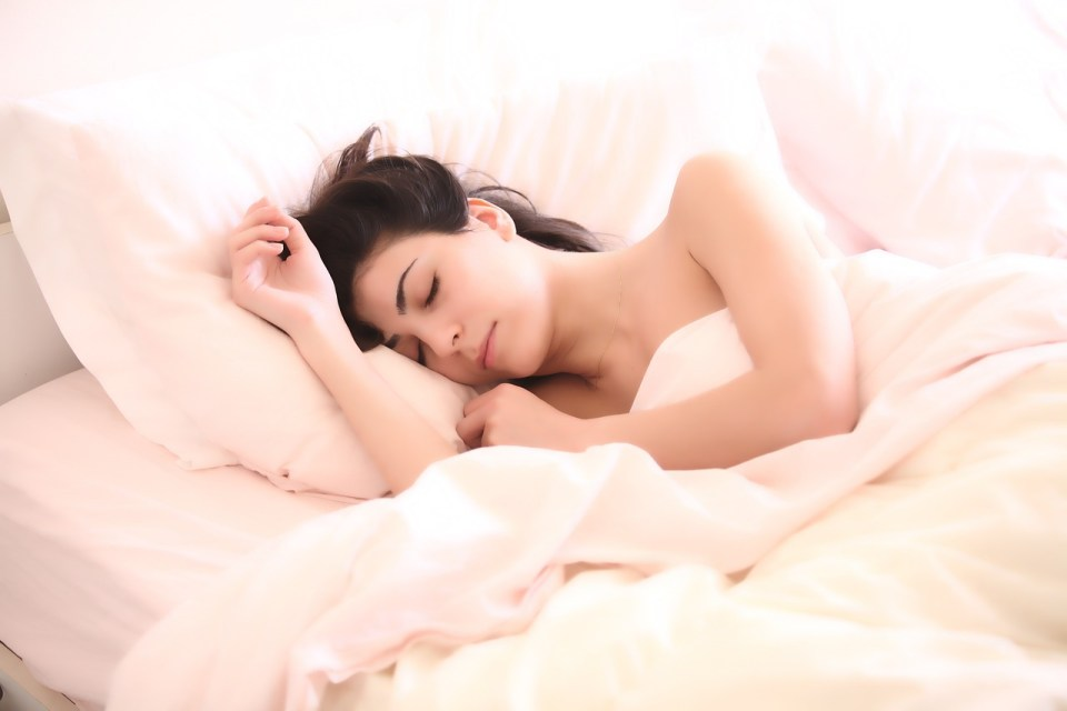 woman sleeping - improve your quality of sleep