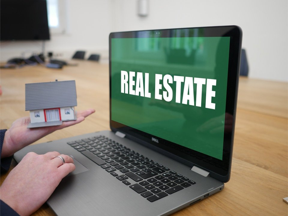 Laptop with the words, Real Estate on the screen