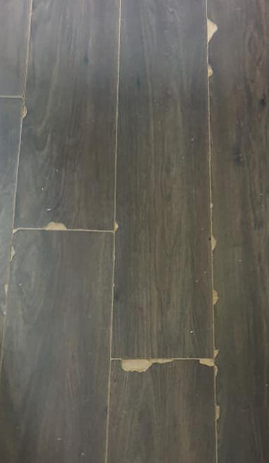 chipped laminate flooring