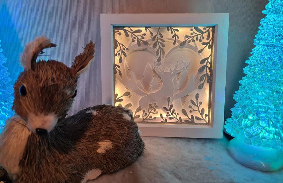 3D layered deer scene from Design Bundles